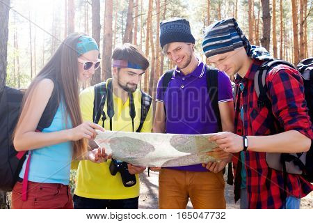 Young Tourists In The Woods