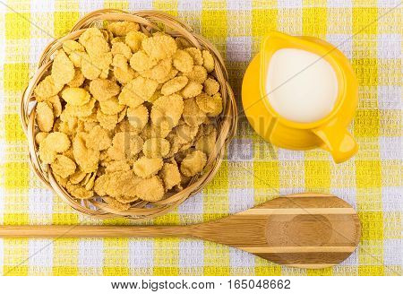 Corn Flakes In Wicker Basket And Spoon On Checkered Tablecloth