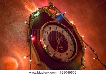 Christmas background with lights on the old clock