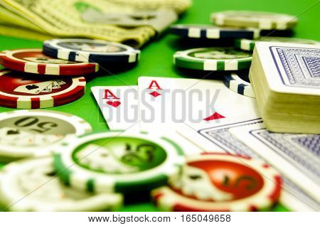 Poker table with chips money and playing cards