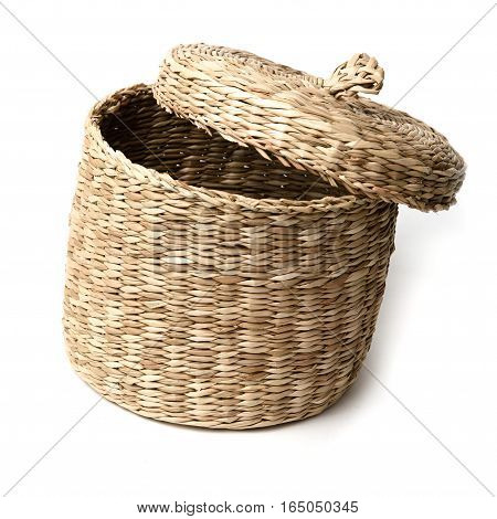 Wicker basket isolated on white background close up.