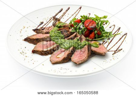 sliced veal steak medium rare with sauce on a white plate white background