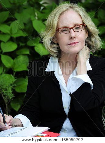 Sexy businesswoman working on a project outdoors.