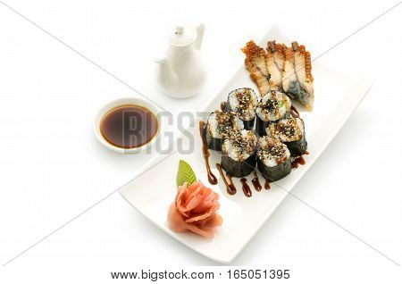 Maki sushi, rolls, nori rice, smoked eel sheets, sesame seeds and teriyaki sauce on a white background