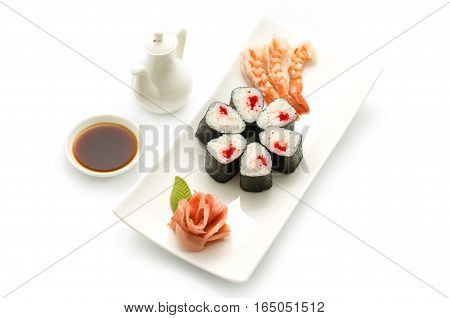 Japanese cuisine. maki with shrimps and flying fish roe. White plate isolated background.
