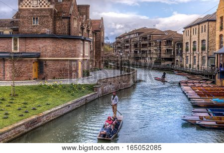 Cambridge UK - 27 February 2016: People enjoying a sunny spring day punting in river Cam in Cambridge UK