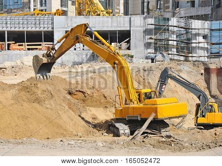 Excavating Machine On Construction Site