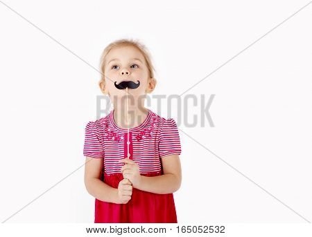 Portrait of smiling girl posing with mustaches on stick. Father day concept. space for text