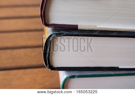 Detail of a stack of hardcover books.