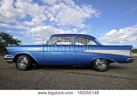 YANKTON, SOUTH DAKOTA, August 19, 2106: The restored classic 1957 Chevy is displayed at the car show at Riverboat Days in Yankton, SD, held  annually each 3rd weekend of August.