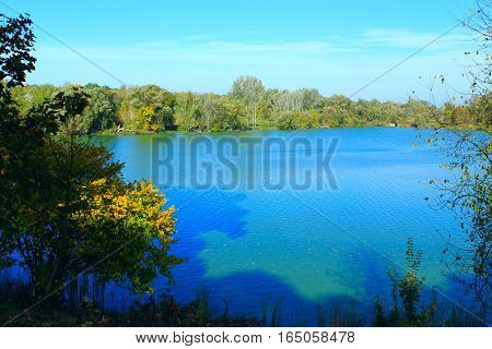 beautiful summer landscape with lake with blue water in the forest