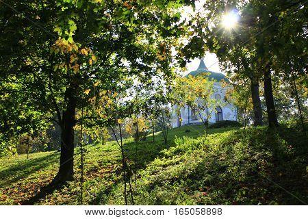 Beautiful Glinka's gazebo on the hill in Kachanivka park among trees