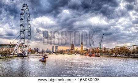 London skyline and Thames river view from embankment bridge