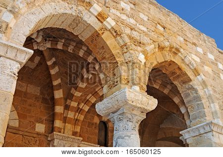 Ancient ornate arab arches in Brindisi Puglia Italy