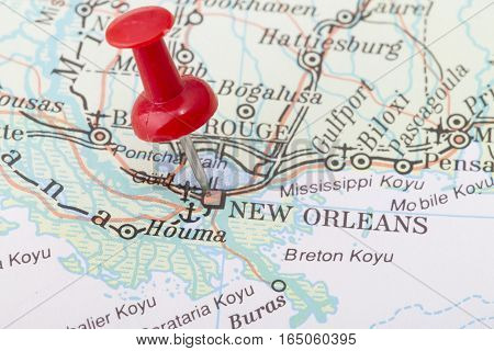 Close up of New Orleans map with red push pin.