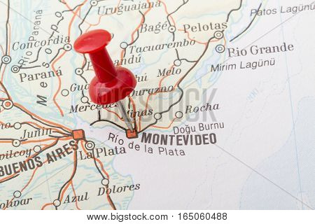 Close up of Montevideo map with red push pin.