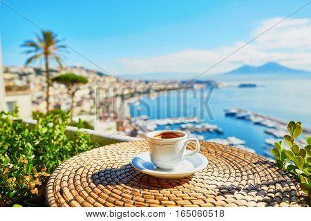 Cup of fresh espresso coffee in a cafe with view on Vesuvius mount in Naples Campania Southern Italy