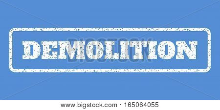 White rubber seal stamp with Demolition text. Vector tag inside rounded rectangular shape. Grunge design and unclean texture for watermark labels. Horisontal emblem on a blue background.