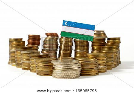 Uzbekistan Flag Waving With Stack Of Money Coins