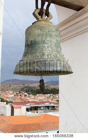 Sucre Bolivia - December 7 2016: Bronze church bell in bell tower of La Merced Church with view of Sucre Bolivia on December 7 2016