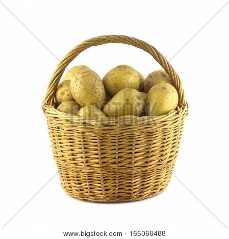 Many ripe potatoes in brown wicker basket isolated on white closeup