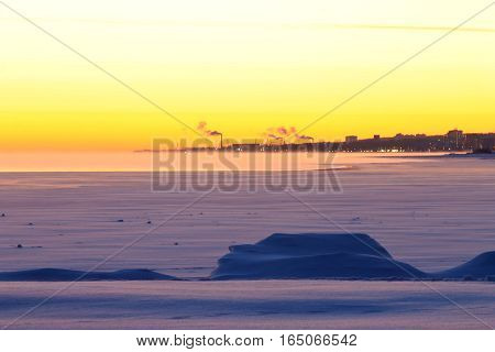 Frozen lake and northern city in the background. Petrozavodsk, Russia