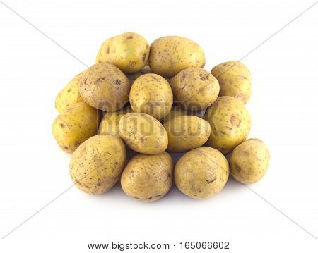 Heap of many ripe brown potatoes isolated on white close up