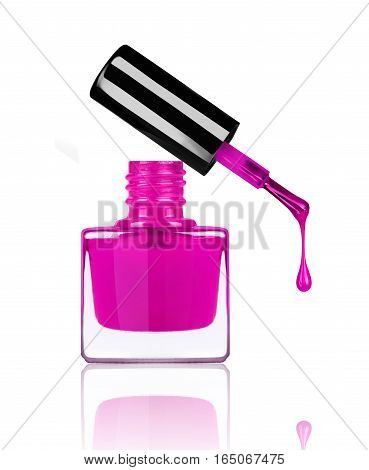 nail polish dripping from brush on white background