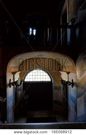 Dark interiors of an old palace and details