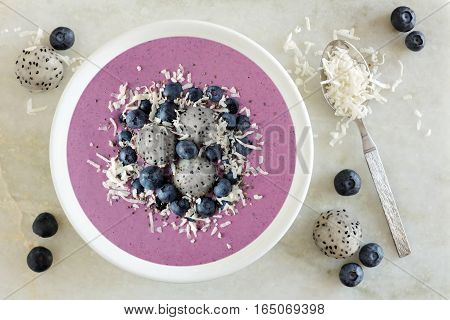 Smoothie Bowl With Blueberries, Dragon Fruit And Coconut, Overhead Scene On Marble