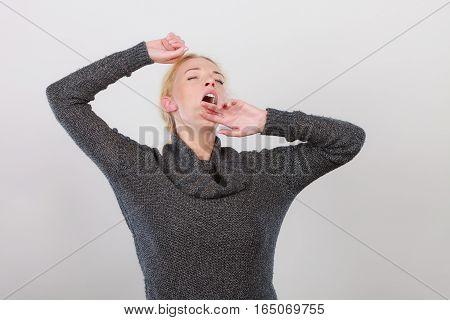 Tiredness bed time concept. Sleepy tired yawning woman stretching herself. Exhausted after long day