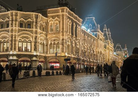 Moscow, Russia- December 16, 2016: People Walking Around Gum Mall With Christmas Lightings. Gum Is L