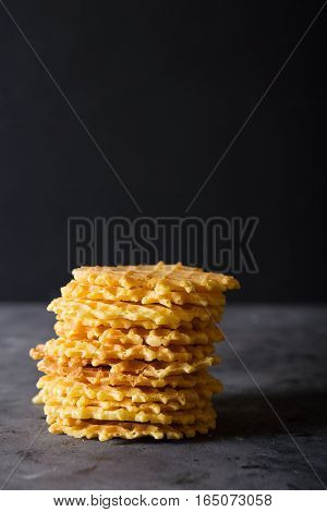 Waffles. Stack Belgian waffles on a dark gray background. Sweet food concept. Copy space.