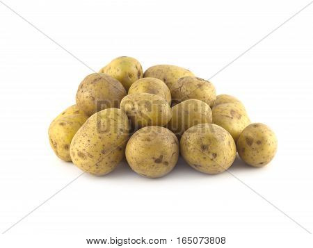 Pile of many ripe brown potatoes isolated on white close up