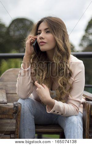 portrait of a serious woman talking via cellphone