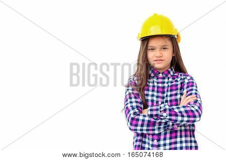Little girl with a yellow helmet standing with arms crossed, Childhood education concept