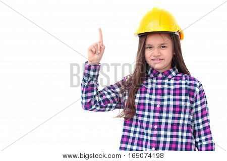 Little girl with a yellow helmet pointing finger up isolate on white