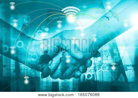 Double Exposure Of Businessman Handshake And Business District Background, Connections Concept. Elem