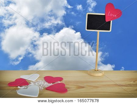 A small heart shaped label on a wooden table clipping path included to remove the background with ease.