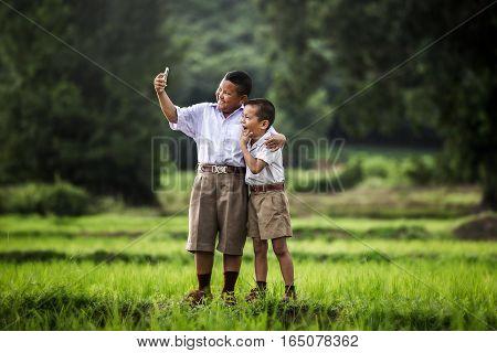 Happy child take a selfie in the cornfield selfie