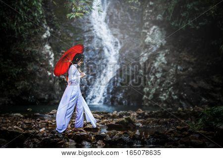 Beautiful woman with Vietnam culture traditional dresstraditional costume Vietnam
