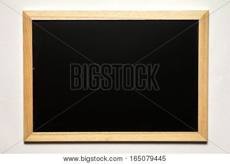Blank black board with wood frame on white background