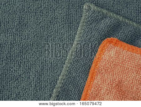 Grey and red microfiber cleaning cloth surface texture background