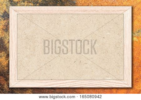 Chipboard or Empty bulletin board with a wooden frame on cement wall background with copy space for text or image.