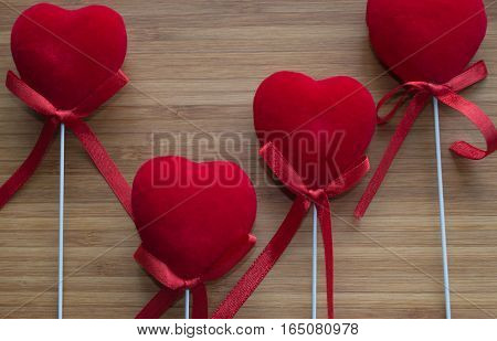 red velvet hearts with sticks  on bamboo board