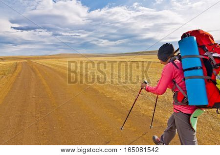 Woman Tourist Walking On A Gravel Road Olkhon Island