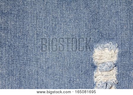 Denim jeans texture or denim jeans background with old torn of fashion jeans design with copy space for text or image.