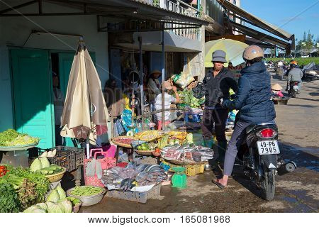 DA LAT, VIETNAM - DECEMBER 28, 2015: Trade in products on the city street