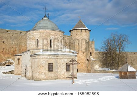 St. Nicholas Church and Gate tower in ancient Russian fortress on the sunny March afternoon. Ivangorod, Russia