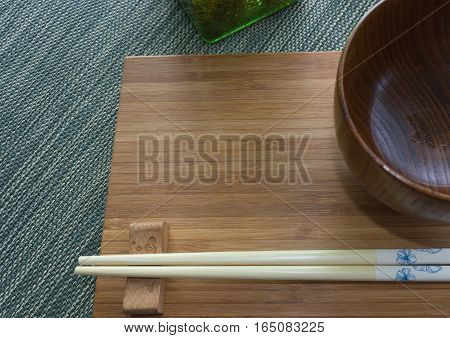 Japanese styled dishes on bamboo board and green rug